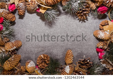 New Year's, Christmas decorations on a gray background (coniferous branches, cones) #1202463544