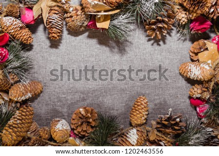 New Year's, Christmas decorations on a gray background (coniferous branches, cones) #1202463556