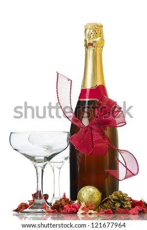 New Year's Day - champagne bottle, two glasses and decoration over white background.