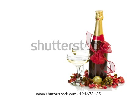 New Year's Day - champagne bottle, two glasses and decoration over white background with copy space.