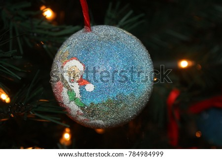 New Year's decoration of santa claus hangs hanging on a tree #784984999
