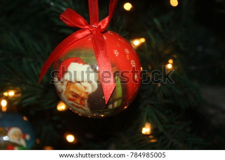 New Year's decoration of santa claus hangs hanging on a tree #784985005