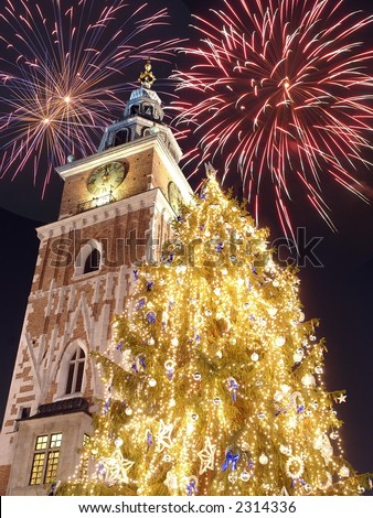 New Year\'s Eve fireworks over historical Town Hall on the Main Market Square in Krakow