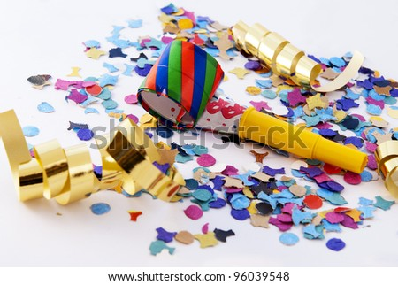 New Year's Eve noisemaker and party confetti