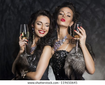 New Year's Eve of two beautiful young women with wine glasses