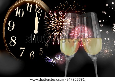 New Year\'s Eve - sparkling wine glasses and fireworks
