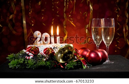 New Year's Eve with a cake with candles and other Christmas decorations