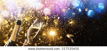New Year\'s fireworks with glasses of champagne. Holiday background