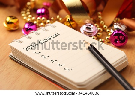New Year\'s goals with colorful decorations. New Year\'s goals are resolutions or promises that people make for the New Year to make their upcoming year better in some way.