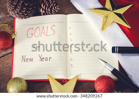 New Year\'s goals with colorful decorations. New Year\'s goals are resolutions or promises that people make for the New Year to make their upcoming year better in some way