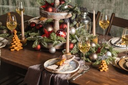 New Year's or Christmas table. The table is covered with food. 2021
