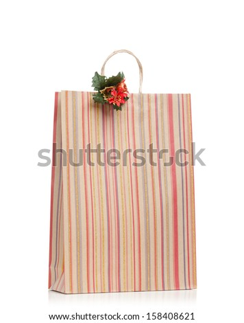 New Year's present in paper bag decorated with ornament, isolated on white