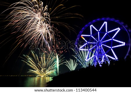 New Year\'s revelers watch fireworks display by bay, Philippines