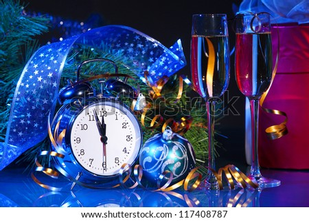 New Year's still life. Decorations and ribbons on a bright color background