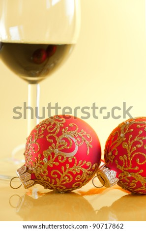 New Year's still life - glasses of wine and Christmas balls - stock photo