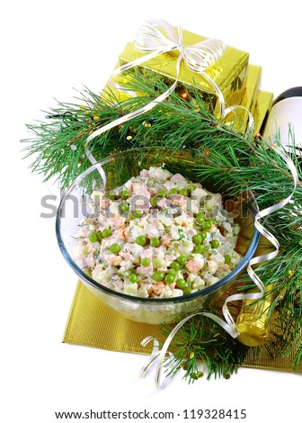 New Year's still-life with a Russian salad and fir branches.