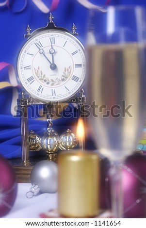 new year's still life with clock, champagne and candles