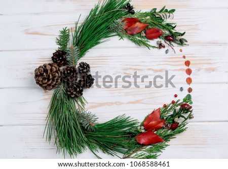 New Year's wreath of twig of twigs and carrots on the table #1068588461