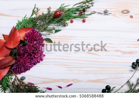 New Year's wreath of twig of twigs and carrots on the table #1068588488