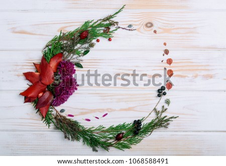 New Year's wreath of twig of twigs and carrots on the table #1068588491