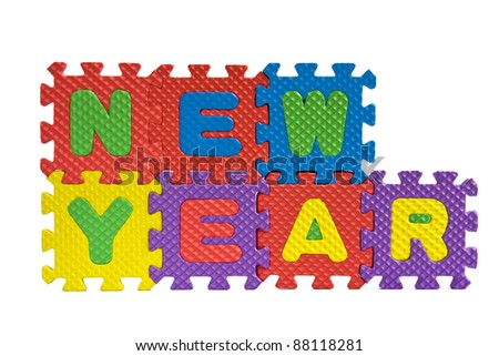 New Year sign with alphabet puzzle pieces isolated on white background