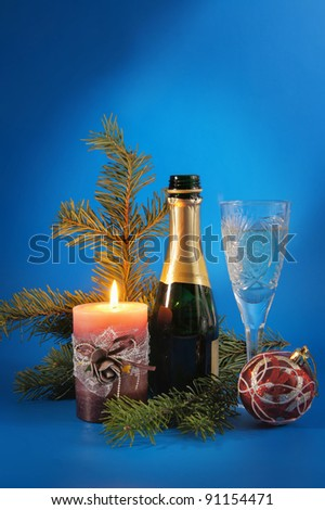 New Year still life with a candle and champagne