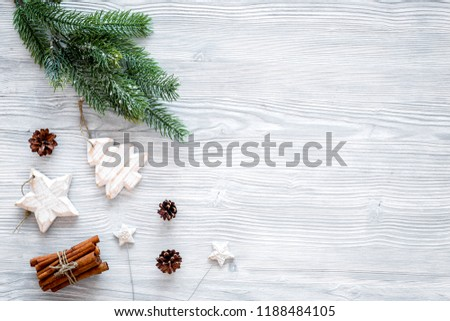 New year symbols. Spruce branch, cones and toys for decoration like spruce and stras on grey background top view space for text #1188484105