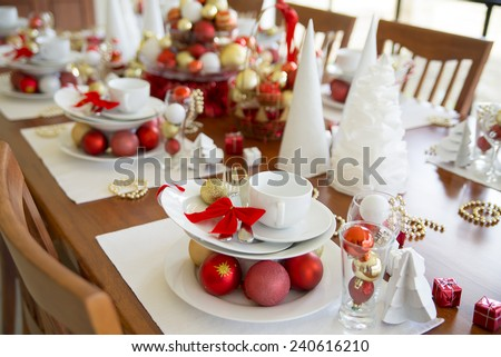 new year table setting decorated with ornaments, christmas table setting