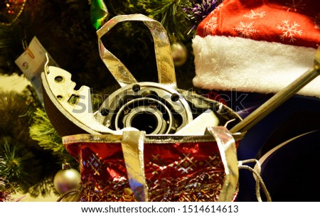 New year theme with auto parts. Auto parts under the tree, a gift for the new year. #1514614613