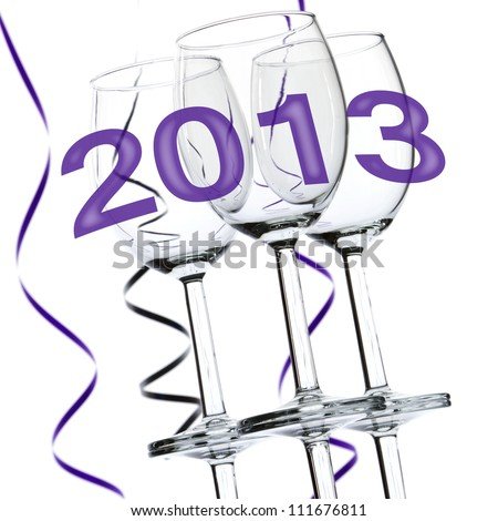 New Year 2013 theme with three wine glasses and party streamers isolated on white background.