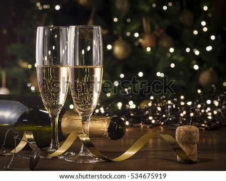 New Year Toast champagne , Christmas tree background #534675919