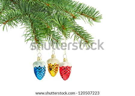 new year toys. Red, yellow and blue cones on christmas tree