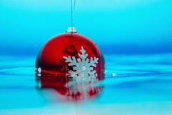 new year tree decoration in the water, christmas decoration in blue water