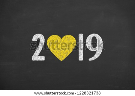 New Year 2019 with Heart Shape on Chalkboard Background