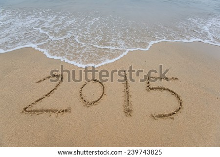new year 2015 written in sand #239743825