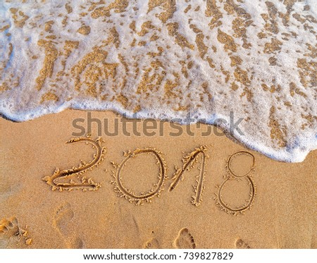 New Year written on sandy beach 2018 is coming  like date holiday concept #739827829