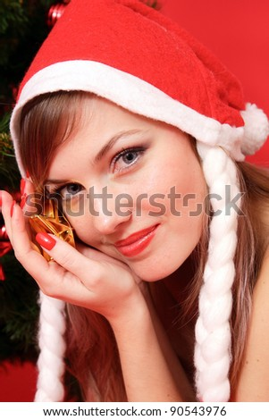 New Year. Young beautiful woman near the Christmas tree.