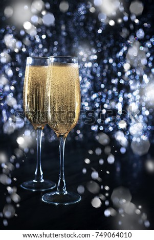 New years eve celebration background with champagne, art Christmas or New Year's party invite, New Year Toast champagne banner, silver background, copy space,  #749064010