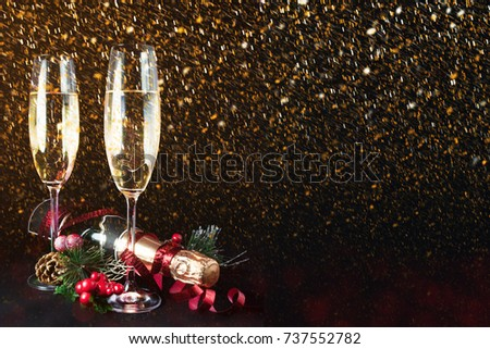 New years eve celebration background with champagne. New Years Eve celebration background with pair of flutes and bottle of champagne  #737552782
