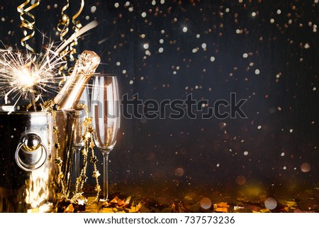 New years eve celebration background with champagne. New Years Eve celebration background with pair of flutes and bottle of champagne  - Shutterstock ID 737573236