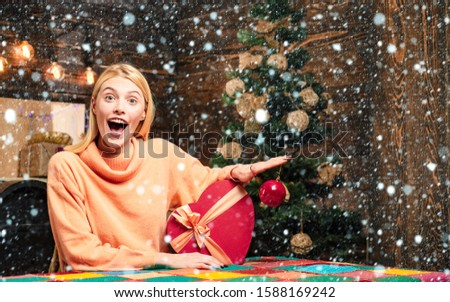 New years eve girl. Give a wink. Portrait of a young smiling woman. Crazy. Crazy comical face. Surprise concept. Friendly and joy