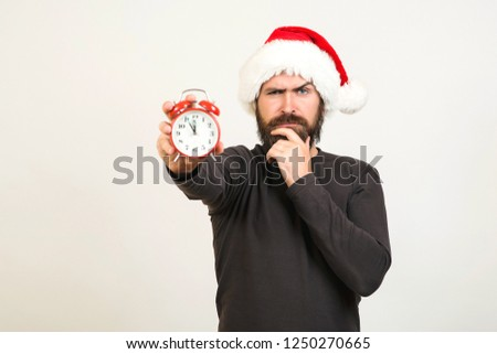 New years eve people. Happy christmas holiday. New years eve celebration. Santa claus holding clock. Christmas holidays composition