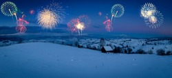New Years firework display in winter alpine mountain landscape. Winter holiday concept
