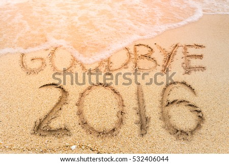 New Years 2017 is coming concept, Goodbye 2016 on the sand beach #532406044