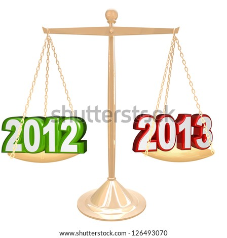 New Years scale balance weighing year numbers 2012 vs 2013 time changing to new year date