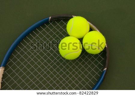 New yellow tennis balls on a green court