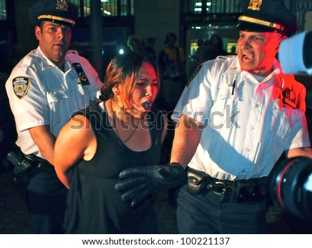 NEW YORK - APR 16: Police arrest an unidentified woman at an Occupy Wall Street rally, April 16, 2012 in New York City. Demonstrators were holding a protest on the steps of Federal Hall.