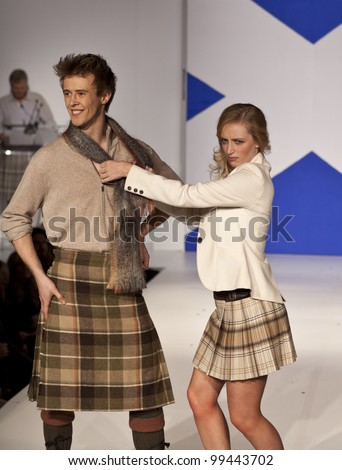 NEW YORK - APRIL 02: Actor Ruari Cannon and actress Elizabeth Ferguson walk runway at fashion show From Scotland With Love at The Liberty Theatre on April 2, 2012 in New York City