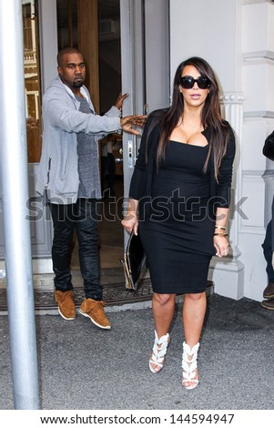 New York, April 22, 2013. Pregnant Kim Kardashian and Kanye West made a quck shopping stop at Isabel Marant store in SoHo in NYC.