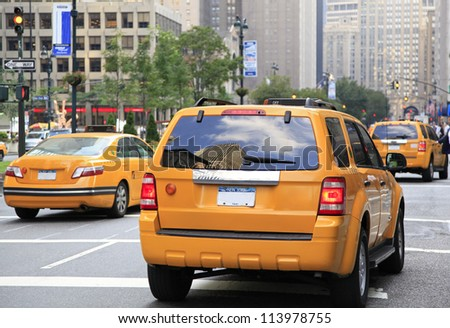 NEW YORK - AUG 24: Busy yellow taxis in traffic. The taxicabs, with their distinctive yellow paint, are a widely recognized icon of the city on August 24, 2012 in New York, USA.